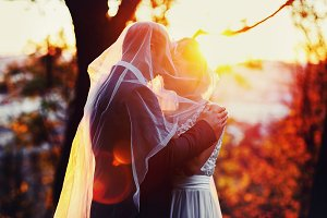 Golden sun shines over newlyweds