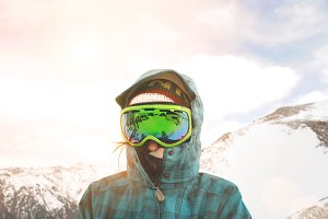Girl learns snowboarding in mountains at winter