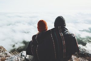 Couple under blanket in mountains