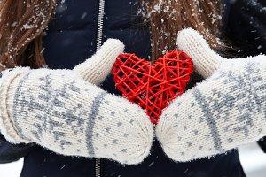 Rattan red heart in hands