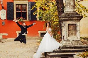 Groom jumps up behind a bride