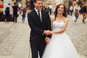 Smiling newlyweds in the old city