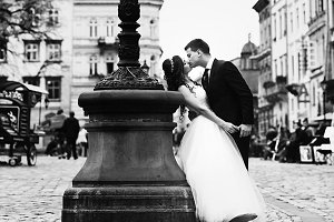 Groom bends bride on the square