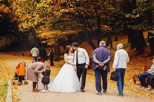 Groom bends bride over in the park
