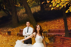 Bride whirls on a pass in a park