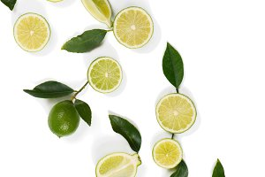 Lime fruits and green leaves.