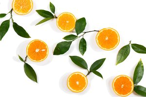 Slices of orange fruits and leaves.