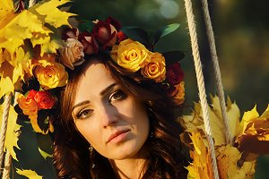 Bride with golden autumn leaves