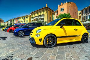 Colorful cars parked in row