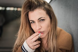 beautiful blond woman smoking