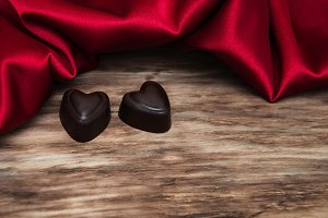 Chocolate candy and red silk