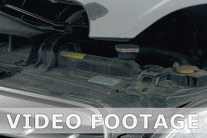 Service man or auto mechanic closes the car hood