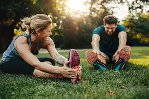 Young caucasian couple exercising