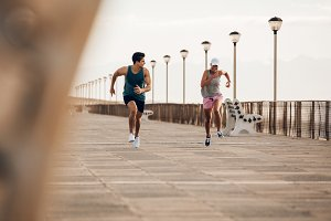 Fitness couple sprinting
