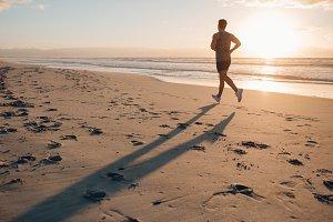 Man on morning run at the beach