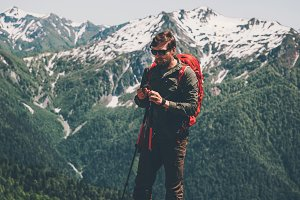Man traveler with backpack trekking
