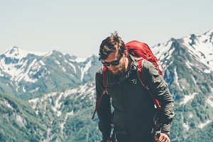 Man traveler with backpack hiking