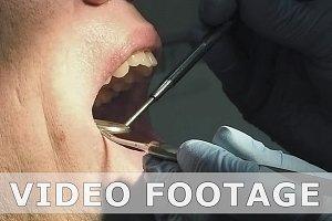 Man gets dentist medical mouth teeth examination