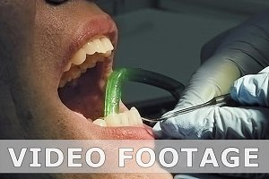 Man gets dental medical examination and treatment