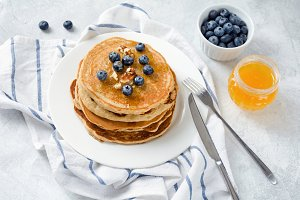 Pancakes with blueberries and nuts