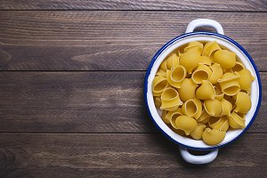 Pasta on metal container. Copy space. Horizontal shoot