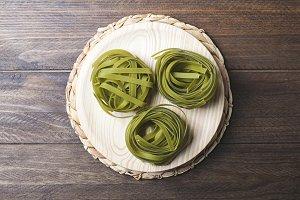 Vegetable spaghetti on wooden table. Horizontal shoot.