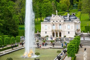 Famous Linderhof Palace and Fountain group on the foreground.