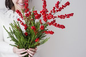 Cute woman holding winterberry
