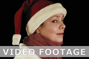 Pretty girl in red Christmas Santa hat smiles