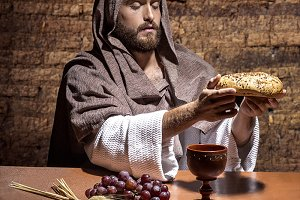 Jesus Christ consecrating
