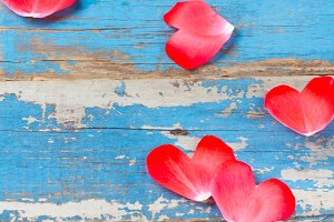 Valentine day background. Roses hearts on wooden blue table
