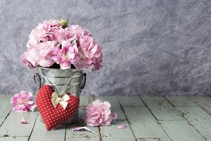Red heart and carnation flowers