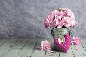 Pink heart and carnation flowers