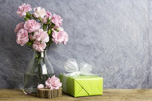 Pink carnation and gift box