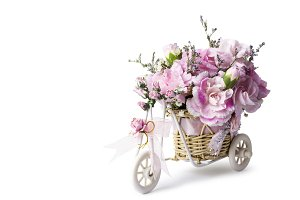 Pink carnation flowers in bicycle