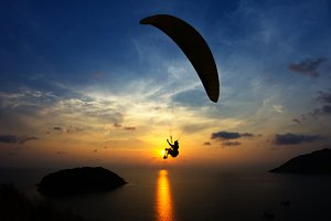 Paraglider chasing the sunset.