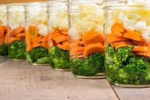 Row of vegetables in jars
