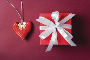 Red gift box and red heart