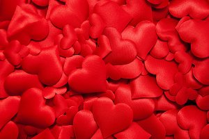 Many red silk hearts