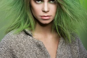 Girl with green colored hairstyle