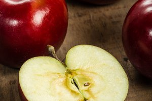 Red apples with cut apple