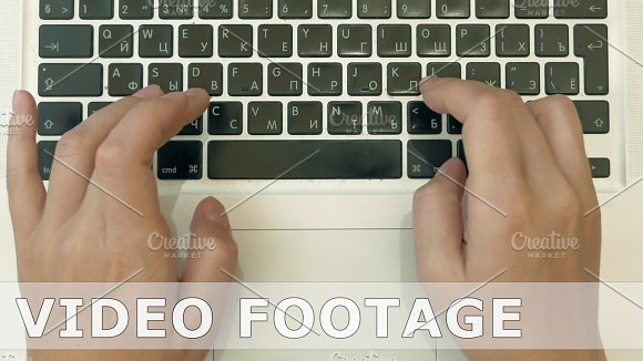 A Person Is Typing On His Laptop Top View POV