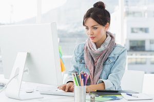 Casual woman using computer in office