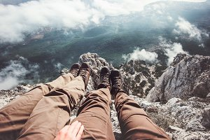 Couple Feet selfie on mountain cliff