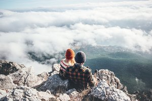 Couple enjoying mountains and clouds