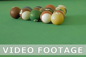 Billiard or pool table with balls being breaking