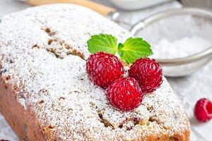 Banana bread with raspberries, cherries and white chocolate, vertical