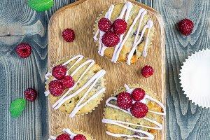 Banana bread muffins with raspberries, cherries, white chocolate, top view