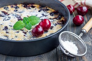 Clafoutis with cherry in baking dish, horizontal