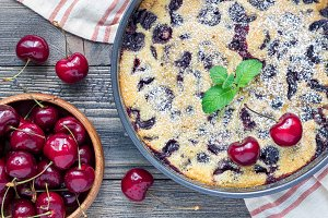 Clafoutis with cherry in baking dish, horizontal, top view